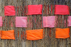 Twigs with interwoven wide orange, pink and coral ribbons of felt. Background of twigs with interwoven wide orange, pink and coral ribbons of felt Stock Images