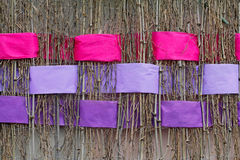 Twigs with interwoven wide pink and violet ribbons of felt. Background of twigs with interwoven wide pink and violet ribbons of felt Stock Photography