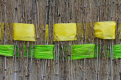 Twigs with interwoven wide yellow and green ribbons of felt. Background of twigs with interwoven wide yellow and green ribbons of felt Royalty Free Stock Images