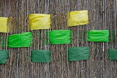 Twigs with interwoven wide yellow and green ribbons of felt. Background of twigs with interwoven wide yellow and green ribbons of felt Stock Photography