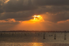 Twilight The bamboo coop for feeding fish. in south of Thailand sea. Songkhla, Koh-Yor Stock Image