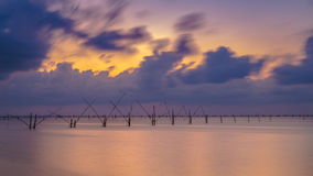 Twilight The bamboo coop for feeding fish. in south of Thailand Stock Photography