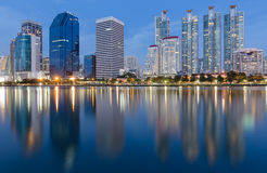 Twilight of Bangkok City downtown with water front reflection Royalty Free Stock Photo