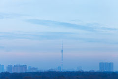 Twilight blue sky over city with TV tower Royalty Free Stock Photos