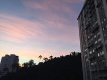 Twilight in Brazil big city Rio. Rio pink sky Royalty Free Stock Photos
