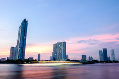 Twilight and the building is beside the chaopraya river in Bangkok Thailand Royalty Free Stock Photos