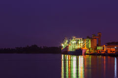 Twilight cargo shipping boat Stock Photography