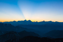 Twilight on Cattle Back Mountain. Panorama view of the twilight with silhouette of mountains and cloudscape on top of Cattle Back Mountain (Niubeishan) in royalty free stock photography