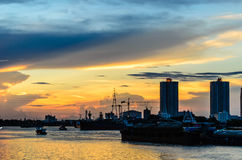The Twilight Of Chao Phraya river. And The Cargo Boat Stock Photography