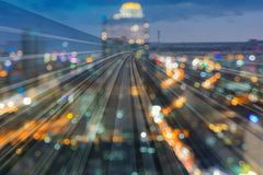 Twilight city blur light downtown double expose train track motion. Abstract background Royalty Free Stock Images