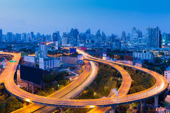 Twilight of city downtown highway curved and interchange Royalty Free Stock Image
