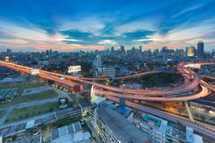 Twilight of city freeway intersection and business area Royalty Free Stock Photo