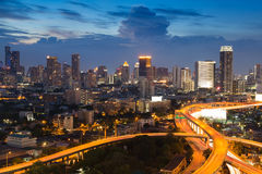 Twilight of City skyline with highway overpass intersection Stock Photos