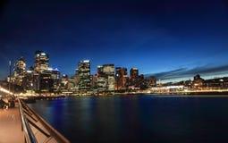 Twilight cityscape Sydney Circular Quay Australia. SYDNEY, CIRCULAR QUAY, AUSTRALIA - NOVEMBER 27, 2013; Nightscape scene of cityscape buildings aglow against a Stock Photography