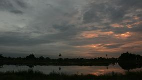 Twilight clouds over the fish pond,Dolly shot stock footage