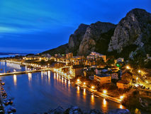 Twilight Croatia. Wonderful colors in the twilight of Omis.  River Cetina, Adriatic sea and mountain Babnjaca is  the keepers of the town of Omis. Horizontal Stock Photography