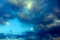Twilight, dark clouds and the moon Royalty Free Stock Photography