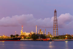 Twilight derrick  petroleum. With boat shipping Royalty Free Stock Image