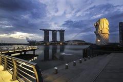 Twilight dramatic sky over merlion Marina bay sand urban travel Stock Photo