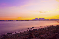 Twilight Dusk. Beautiful clouds over the calm sea. Royalty Free Stock Photo
