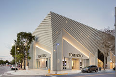 Twilight Exterior of Tom Ford Shop in Midtown Miami. MIAMI, FL - DECEMBER 31 2014 - Miami's central art district in the Wynwood and Edgewater neighborhoods Stock Image