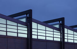 Twilight factory. Detail of a modern industrial building (sRGB Stock Image