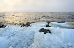 Twilight foggy rubble ice Baltic seashore landscape Stock Image