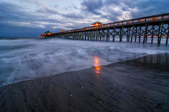Twilight, Folly Pier SC. Twilight and rushing waves at the Folly Beach Pier in SC Royalty Free Stock Photo