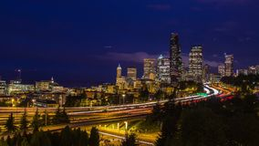 Twilight Freeway Traffic Time Lapse in Seattle. WA, USA. High impact busy traffic on highway 5 going on both direction at night stock video