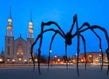 Twilight Giant Spider and Church stock photography