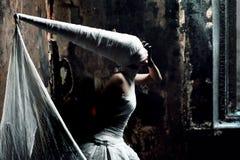Twilight girl. Shot of a twilight girl in white dress. Halloween, horror Stock Image