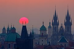 Twilight in historical city. Magical picture of tower with orange sun in Prague, Czech Republic, Europe. Beautiful detailed sunris Royalty Free Stock Images