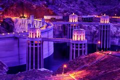Twilight at the Hoover Dam, Arizona-Nevada Border. Twilight with a purple haze at the historic Hoover Dam on the Arizona-Nevada Border stock image