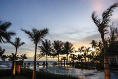 Twilight  hotel pool on the sea shore. Royalty Free Stock Photos