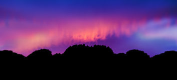 Twilight Impressionist. Panorama of Silhouette landscape at sunset Stock Image