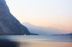 Twilight on the Lake. Twilight on Lake Como with sailboat Stock Image