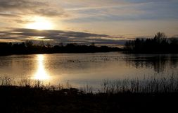 Twilight by the lake. Cloudy landscape during sunset on Forfar lake in Scotland Royalty Free Stock Photography