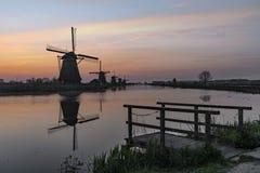 Windmill sunrise silhouette. Twilight light sunrise on the Unesco hege windmill silhouette at the middle of the canal, Alblasserdam, Netherlands stock photos