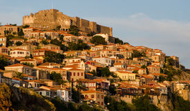 Twilight at Molyvos on the island of Lesvos in Greece. White houses with red roofs and the castle at sunset on Lesvos stock photography