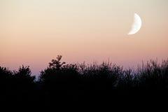 Twilight Moon. Silhouette landscape photo of twilight moon Royalty Free Stock Photos