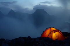 Twilight in the mountains. And orange lighting tent Royalty Free Stock Images