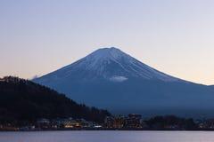 Twilight of Mt fuji and the city around kawaguchi lake, japan stock photography