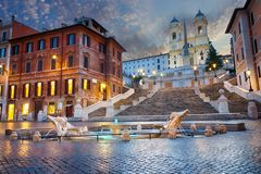 Twilight near the Spanish Steps and the Fontana della Barcaccia in Piazza di Spagna, Rome, Italy royalty free stock photo