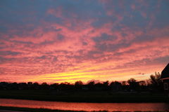 Twilight in The Netherlands. The beautifull skies at the evening in The Netherlands.  in red and blue colours. location was Berkel en Rodenrijs, South- Holland Royalty Free Stock Photos