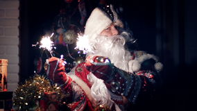 In the twilight of the night, Santa Claus cheerfully waves Bengal lights stock footage