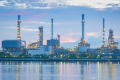 Twilight of the oil refinery plant. Royalty Free Stock Images