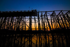 Twilight of old wooden bridge across the river and Wood bridge Royalty Free Stock Photos