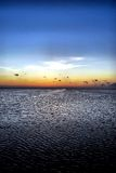 Twilight over the bay. Twilight glows over the wind-ruffled surface of the water of the Laguna Madre bay at South Padre Island, Texas Royalty Free Stock Photography