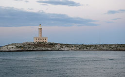 Twilight over the lighthouse in Vieste Royalty Free Stock Images
