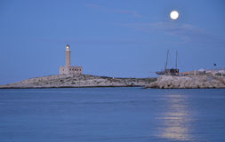 Twilight over a lighthouse in Vieste town, Italy Royalty Free Stock Images
